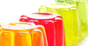 closeup of gelatin of different colors on a white background